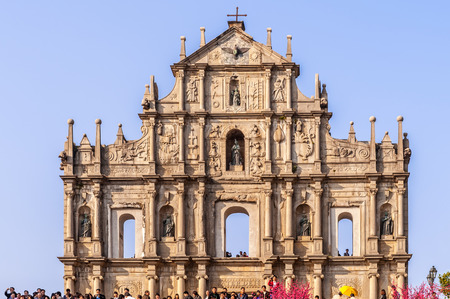 Macau, China - February 1, 2009: Tourists gather in front of facade of  the Jesuits cathedral church in Macau Stock Photo
