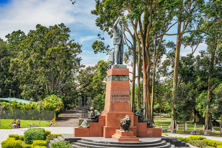 principal: San Jose, Costa Rica - November 10, 2016: The statue of 1930s president León Cortes located at the principal entrance at the west end of Paseo Colon. Behind the statue La Sabana was once San Jose airport. Editorial