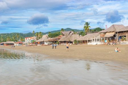 sur: San Juan del Sur, Nicaragua - November 18, 2016:  Main beach of San Juan del Sur, and various restaurants and hotels overlooking Pacific Ocean shore.