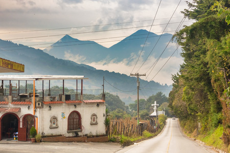 Santa Maria de Jesus, Guatemala - December 5, 2016: Dirt road and the volcanic mountains at the background just outside of the town of Santa Maria de Jesus in Guatemala Editorial