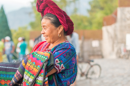 Panajachel, Guatemala - December 7, 2016: Portrait of the woman selling goods on the street of touristic town of Panajachel in Guatemala.