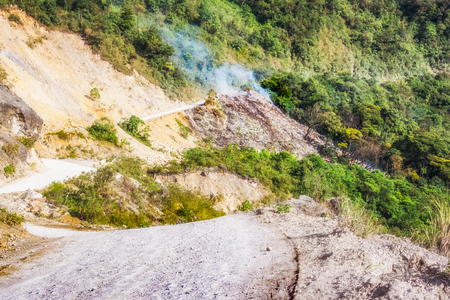 cristobal: Burning garbage by the road in the mountains near San Cristobal Verapaz, Guatemala.