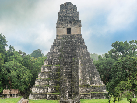 Tikal is the ruins of an ancient city found in a rainforest in Guatemala. Tikal was the capital of a conquest state that became one of the most powerful kingdoms of the ancient Maya. Though monumental architecture at the site dates back as far as the 4th Stock Photo - 75000595