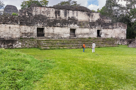 Tikal, Guatemala - December 15, 2016: Tourists visiting the Maya ruins of Tikal, near Flores, Guatemala