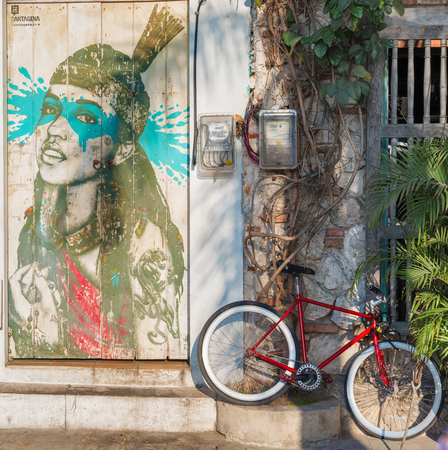 Cartagena, Colombia - March 20, 2017: Street art graffiti of India Catalina on a wall in the street in Getsemani area of Cartagena, Colombia, South America Editorial