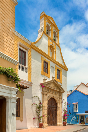Cartagena, Colombia - March 26, 2017: View at the facade of Santo Toribio Church. It  is one of the smallest churches in Old Town, but no less historic. Construction began by the Spaniards in 1666 and was completed about 65 years later.