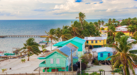 Caye Caulker, Belize - December 24, 2016: Aerial view at wooden pier dock  and picturesque, relaxing ocean view at Caye Caulker Belize Caribbean. Editorial