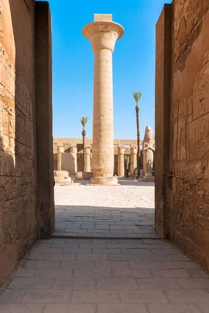 Pillars, obelisk and statue of the Karnak temple, Luxor, Egypt, Ancient Thebes with its Necropolis.