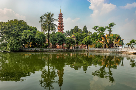 View over the lake at Tran Quoc Pagoda  the oldest Buddhist temple in Hanoi, is located on a small island near the southeastern shore of Hanoi West Lake.  Originally constructed in the sixth century during the reign of Emperor Ly Nam De, from 544 until 54 Editorial