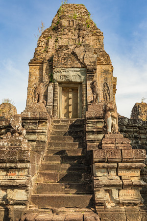 Pre Rup is a Hindu temple at Angkor, Cambodia, built as state temple of Khmer king and dedicated in 961. It is a temple mountain of combined brick, laterite and sandstone construction. Фото со стока