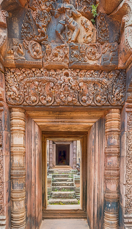 Banteay Srei is 10th century Cambodian temple dedicated to Hindu god Shiva. Located 25 km of main group of temples. It is built largely of red sandstone, and have elaborate decorative wall carvings.