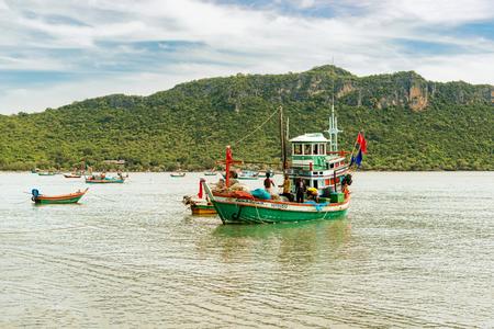 Prachuap Khiri Khan, Thailand - Nov 27, 2017: Fisherman on the boat at anchorage at the bay of the Gulf of Thailand near Prachuap Khiri Khan.
