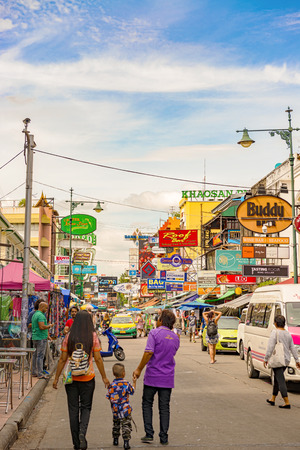 Bangkok, Thailand – Nov 24, 2017: People visiting Khaosan Road it is world famous backpacker place, offers cheap accommodation. During evening, street turn into bars and music is played.