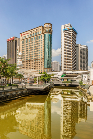 Kuala Lumpur, Malaysia - Dec 13, 2017: Canal at the Historical Masjid Jamek Mosque and the modern buildings in the center of Kuala Lumpur, Malaysia. Editorial