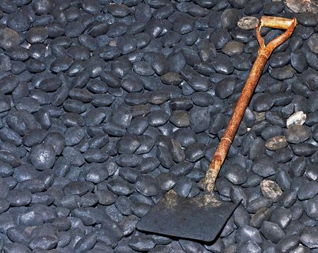 Heap of Coal with Shovel Фото со стока