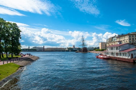 Beautiful view of the Neva river with sailing vessel on skyline of the city photo