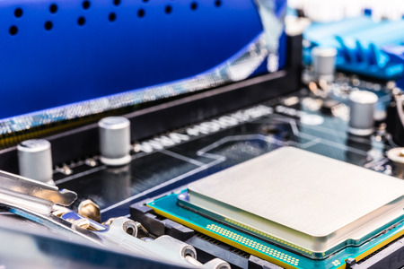 memory board: Memory chip and processor on the system board Stock Photo
