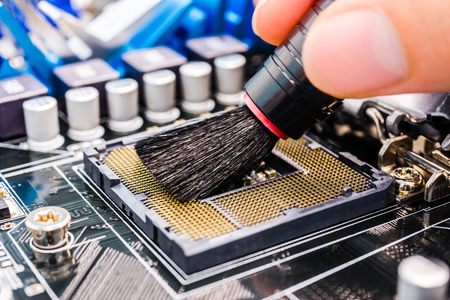Cleaning of the computer with brush photo