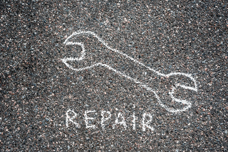 jack tar: Repair sign on the asphalt