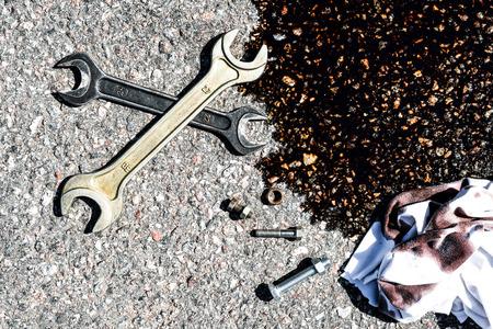 Tools on the asphalt, repair concept photo