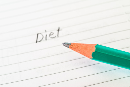 weightloss plan: Diet sign in the notebook by pencil Stock Photo