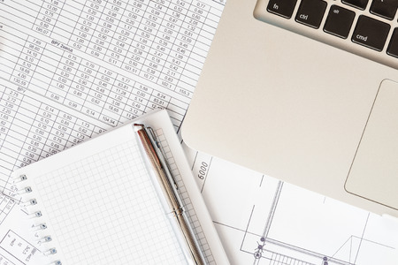 personal digital assistant: Preparation of financial statements for the project, a notebook with a pen on the table