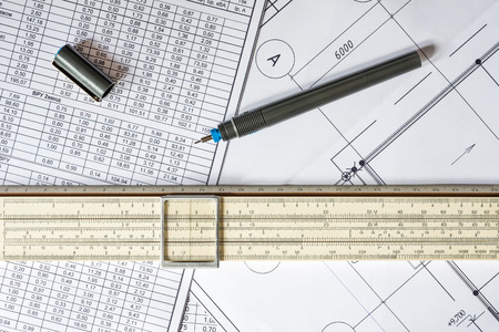 land slide: Drawing house plan, slide rule and pencil on the table