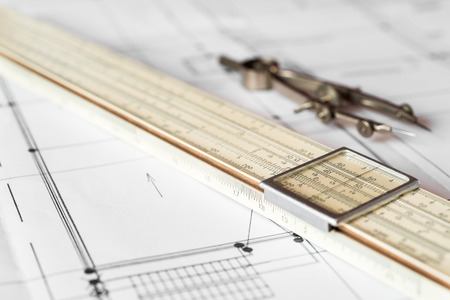 drafting tools: Preparation for drafting papers, the tools and schemes on the table. Angle view