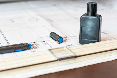 communications tools: Workplace of engineer, tools for sketching and plan of the communications. Angle view Stock Photo