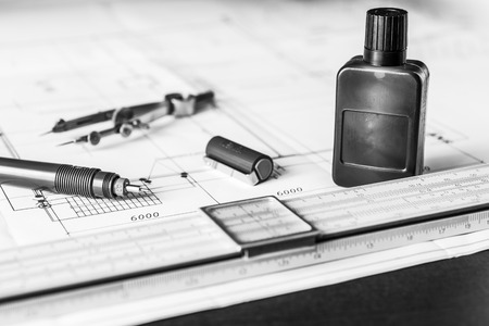 delineation: Slide rule with diagrams and drawing tools on the table. Angle view, in black and white tones Stock Photo