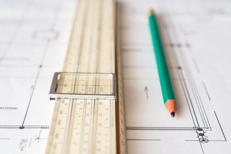 land slide: Tools for sketching, a pencil and scheme on the table. Angle view