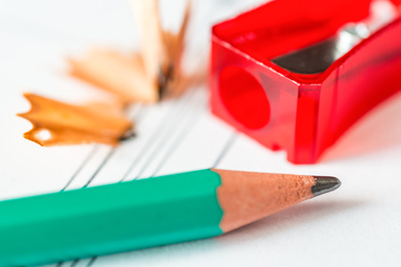 sharpen: Preparation for work, sharpen a pencil. Angle view close-up Stock Photo