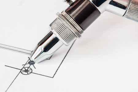 office physical pressure paper: Work with the airbrush over the drawing. Angle view Stock Photo