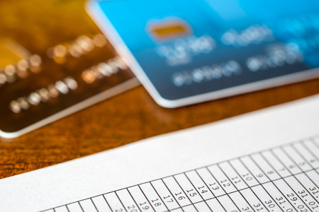 pay for: To pay for the credit, payment cards and payment sheet on the table