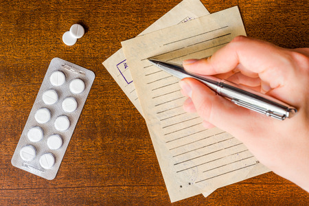 prescribe: Cure the disease, a doctor prescribe the right tablets in the recipe Stock Photo