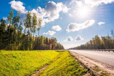 the nature of sunlight: Midday sun on country roads in the forest Stock Photo