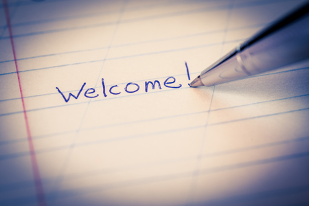 welcome sign: Welcome sign in the notebook. Image vignetting in the blue tones Stock Photo