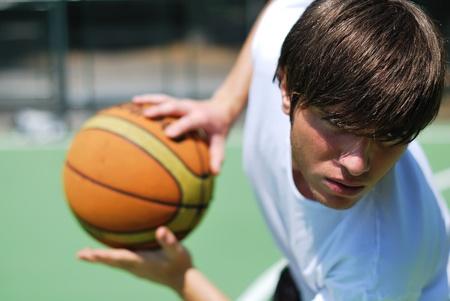Boy playing basketball - Ball blurred background Stock Photo - 9822697