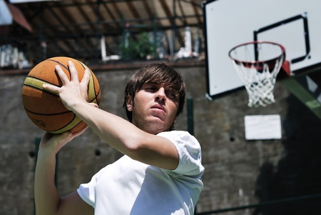 Boy playing basketball - with blurred background photo