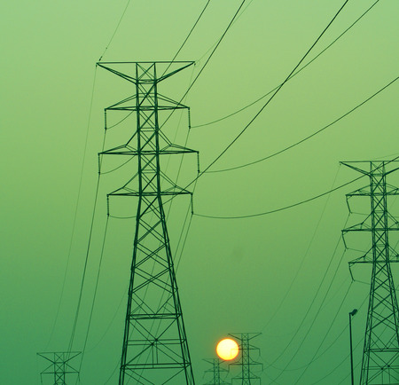 Sun rise over electric power lines
