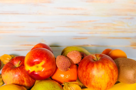 fruit collection on a woody background