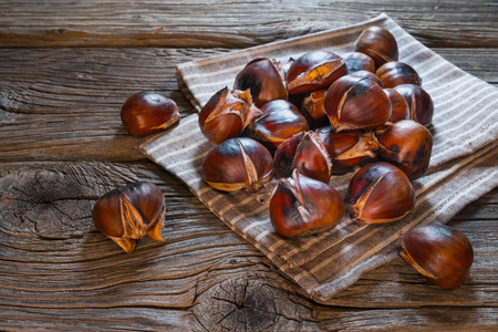 Roasted chestnuts on a towel Stock Photo