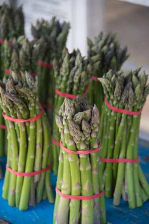 Asparagus making a neat display on table in front of shop selling local produce