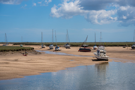 beached: Beached boats at low tide in the estary at Wells Next the Sea, Norfolk