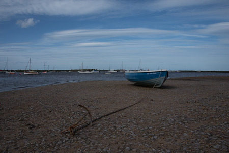 Blue boat beached at Staithes harbour in Norfolk.
