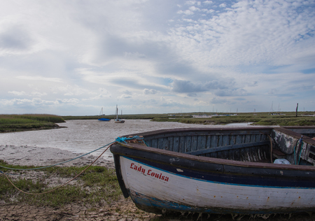 Boats moored at Burnham Staithes in North Norfolk.