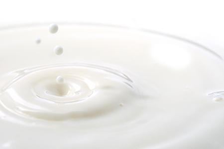 splashing: Macro shot of splashing milk droplets.