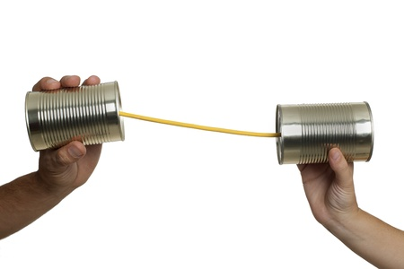 tin can telephone: Concept about communications with 2 tin cans and a string, in white background, isolated