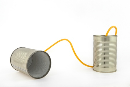 Concept about communications with 2 tin cans and a string, in white background, isolated Stock fotó - 16974294