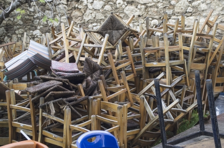 Old chairs on a pile under natural lights